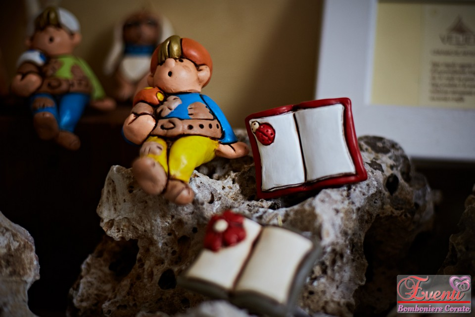Baby Love e libri Laurea in terracotta